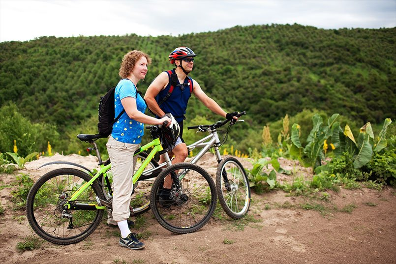 ​Daniel Atlas with wife cycling